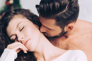 close up view of man kissing beautif