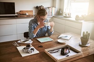 Young woman drinking coffee and work