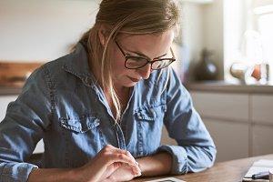 Focused young female entrepreneur wo