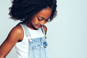 Shy young African girl looking down