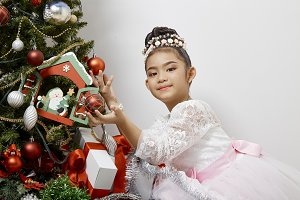 Cute little asian girl Merry Christm
