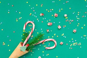 Christmas card with candy canes in w
