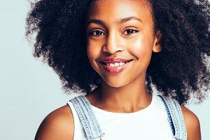 Cute little African girl smiling aga