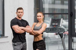 muscular bodybuilders standing with