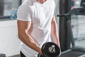 handsome muscular bodybuilder exerci
