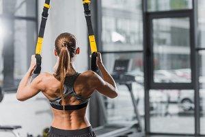 rear view of muscular sportswoman tr
