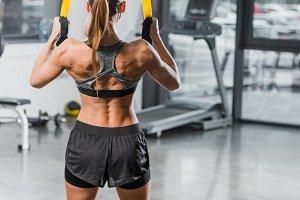 back view of muscular sportswoman wo