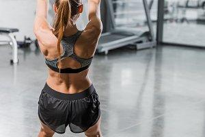 back view of muscular sportswoman tr