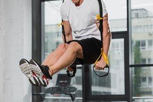 handsome athletic bodybuilder exerci