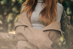 Photo of young brunette in coat in