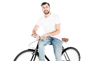Handsome smiling man riding bicycle