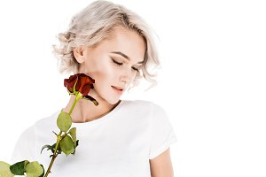 Attractive  woman holding red flower