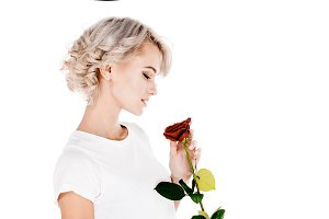 Beautiful woman holding red flower i