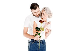 Beautiful couple with flower hugging