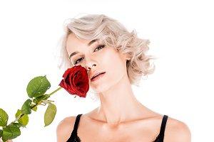Amazing blonde woman holding beautif