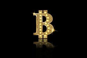 Golden and silver bitcoin coin.