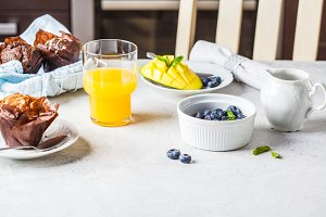 Breakfast served with muffins, juice