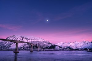 Bridge against snowy mountains