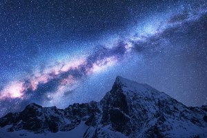 Milky Way above snowy mountains
