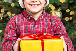 Christmas child with present box.