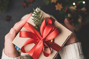 Holding Christmas gift box