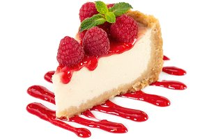 Piece of cheesecake with raspberries
