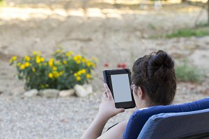 Reading in a tablet, outdoors