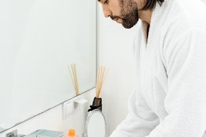 adult handsome man in bathrobe washi