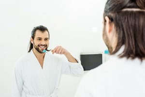 handsome adult man in white bathrobe