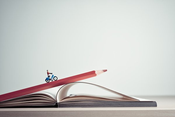 Transportation Stock Photos - Girl rides on a motorcycle over book