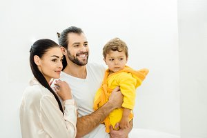 happy young family with cute son in