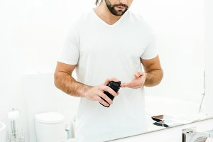 Man holding shaving foam in front of