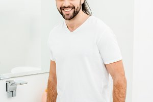 Young man in white T-shirt smiling i