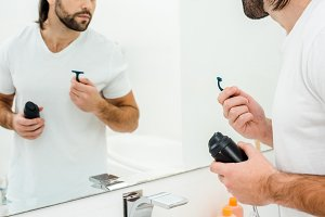 Man holding in hands shaving accesso