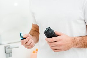 Man holding in hands safety razor an