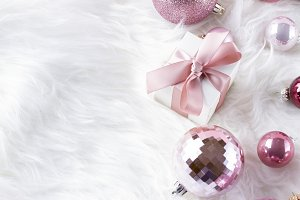 Pink Christmas decorations on white