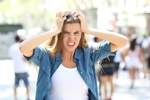 Stressful furious girl in the street