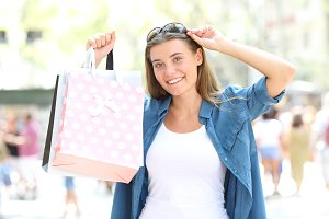 Shopper showing blank shopping bags