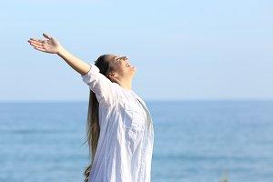 Satisfied woman breathing on