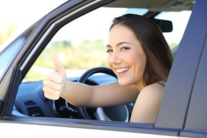 Satisfied driver with thumbs up in a