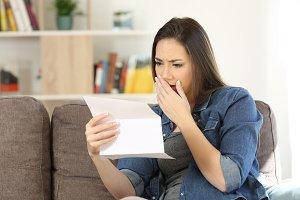 Sad woman reading bad news