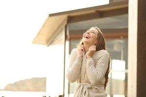 Cheerful hotel guest breathing fresh