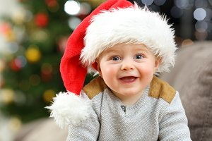 Cheerful baby looking at you