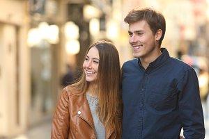Happy couple dating walking