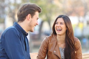 Funny couple laughing in the street