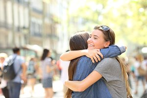 Friends hug in the street