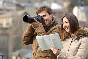 Couple of tourists taking photos