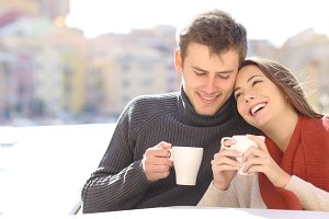 Couple in love flirting in a coffee