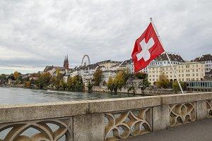 Swiss flag over the river Rhine in B
