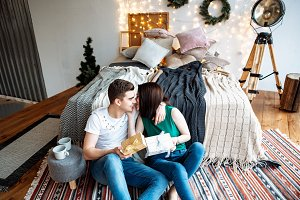 lovers exchange gifts